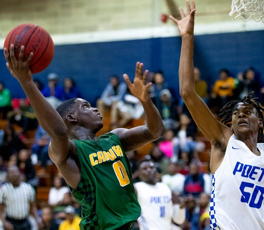 Carver's Jalen Walton (0) goes against Lanier's Terrell Wright (50) on the Lanier campus in Montgomery, Ala., on Friday January 24, 2020.