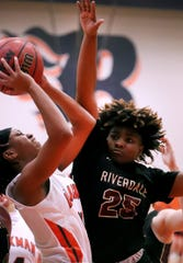 Blackman's guard Joelle Patton (14) goes up for a shot as Riverdale's Kelsie Prather (25) guards her on Friday, Jan. 24, 2020, at Blackman.