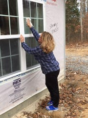 Robbi Borghi, a Realtor with Coldwell Banker Lakeside Realtors, participates in a Habitat for Humanity build.