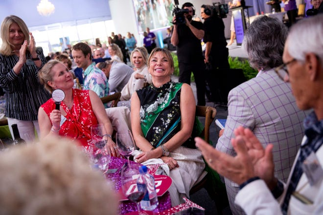 Attendees bid on a lot during the Naples Winter Wine Festival live auction at The Ritz-Carlton Golf Resort in Naples on Saturday, January 25, 2020.