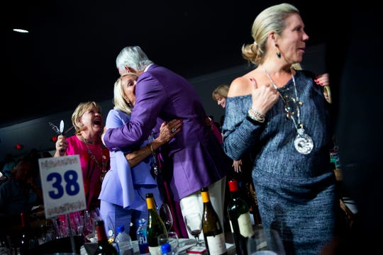 "Penny Anderson hugs Lee Anderson after winning lot 60, ""The St. Barths Vibe avec Cuvée"" during the Naples Winter Wine Festival live auction at The Ritz-Carlton Golf Resort in Naples on Saturday, January 25, 2020."