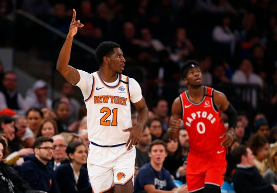 Jan 24, 2020; New York, New York, USA;  New York Knicks guard Damyean Dotson (21) reacts after three point basket against the Toronto Raptors during the first half at Madison Square Garden.