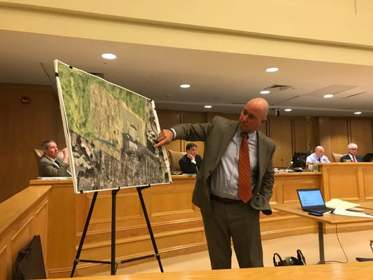 Mahwah engineer Mike Kelly explains extent of wetlands surrounding Fire Company 3 on Rozanski  Drive.