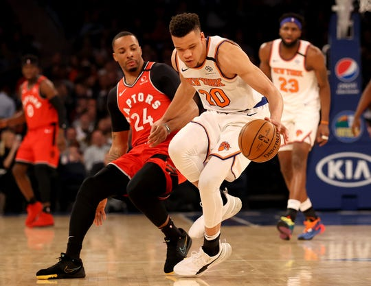Kevin Knox II #20 of the New York Knicks and Norman Powell #24 of the Toronto Raptors chase after a loose ball in the first half at Madison Square Garden on Jan. 24, 2020 in New York.