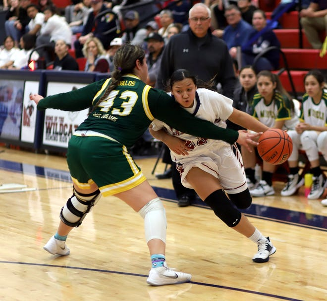 Sophomore Lady 'Cat Harmanie Dominguez took Mayfield's Kayla Avalos (43) off the dribble to two of her game-high 32 points. Avalos and the Trojans picked up a 66-56 victory Friday.