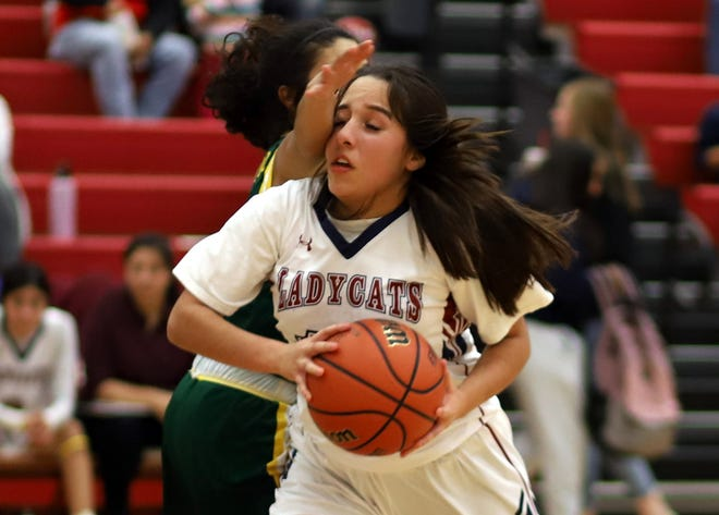 Senior Lady 'Cat guard Nicole Lopez found a congested key area on her way to the basket.