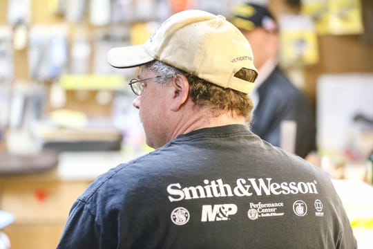 Emerson Gates, inside the Custom Cartridge Company in Las Cruces on Saturday, Jan. 25, 2020, talks about the county's proposed resolution to support a red flag bill in the state Senate.