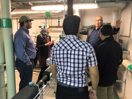 Per Rosen, Ectogrid, showing equipment to an NMSU engineering student team in a mechanical room at Medicon Village, a prototype community that uses a small thermal grid for electrical power.