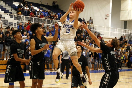Carlsbad's Riley Hestand takes a contested shot against Santa Teresa on Jan. 24, 2020. Hestand finished with seven points and Carlsbad won, 57-49.