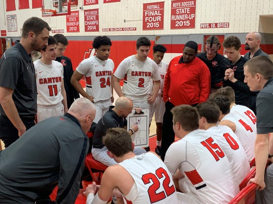 Canton basketball coach Jimmy Reddy talks to his team during a timeout in a game against Howell on Jan. 24, 2020.