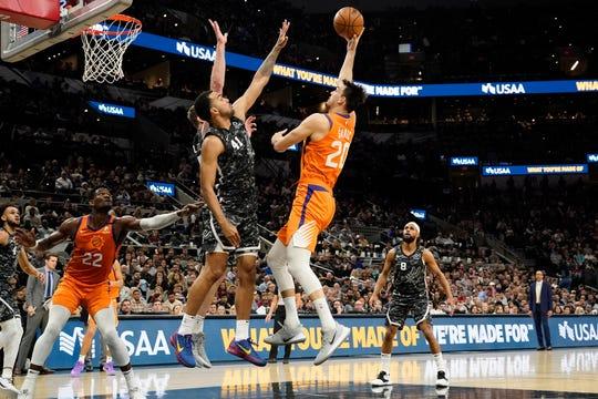 Jan 24, 2020; San Antonio, Texas, USA; Phoenix Suns forward Dario Saric (20) shoots over San Antonio Spurs forward Trey Lyles (41) and center Jakob Poeltl (25) in the first half at AT&T Center. Mandatory Credit: Scott Wachter-USA TODAY Sports