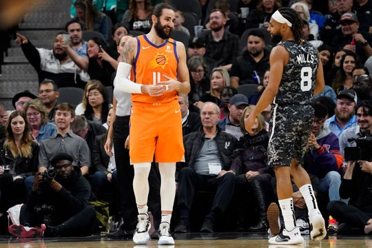 Jan 24, 2020; San Antonio, Texas, USA; Phoenix Suns guard Ricky Rubio (11) reacts with San Antonio Spurs guard Patty Mills (8) in the first half at AT&T Center. Mandatory Credit: Scott Wachter-USA TODAY Sports