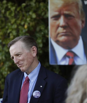 Rep. Paul Gosar speaks with constituents during an Arizona Republican Party meeting at Church for the Nations in Phoenix, Ariz., on Jan. 25, 2020.