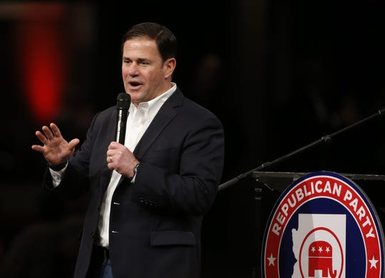 Gov. Doug Ducey speaks with those in attendance during an Arizona Republican Party meeting at Church for the Nations in Phoenix on Jan. 25, 2020.