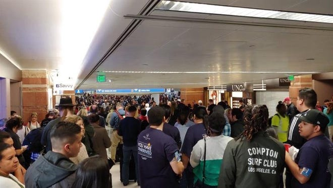 Part of a concourse at Phoenix Sky Harbor International Airport was clearedFriday evening as police dealt with a passenger who was upset about not being ableto board a plane, Phoenix police said.