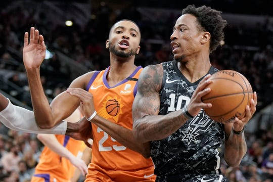San Antonio Spurs' DeMar DeRozan (10) drives against Phoenix Suns' Mikal Bridges during the first half of an NBA basketball game, Friday, Jan. 24, 2020, in San Antonio. Phoenix won 103-99. (AP Photo/Darren Abate)