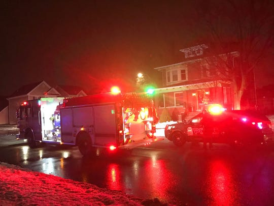Port Huron Fire Department and Port Huron Police Department respond to a crash at the intersection of Griswold and 7th streets in Port Huron on Jan. 24, 2020.