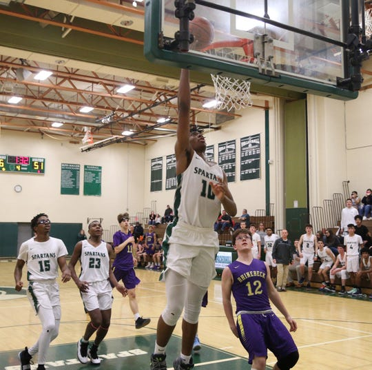 Spackenkill's Jaylen Rouse goes up for a layup against Rhinebeck during a Jan. 24 boys basketball game.