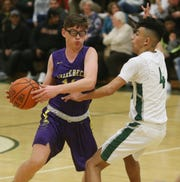Spackenkill's Brandon Bairan covers Rhinebeck's Bryce Aierstock during Friday's game in the Town of Poughkeepsie on January 24, 2020.