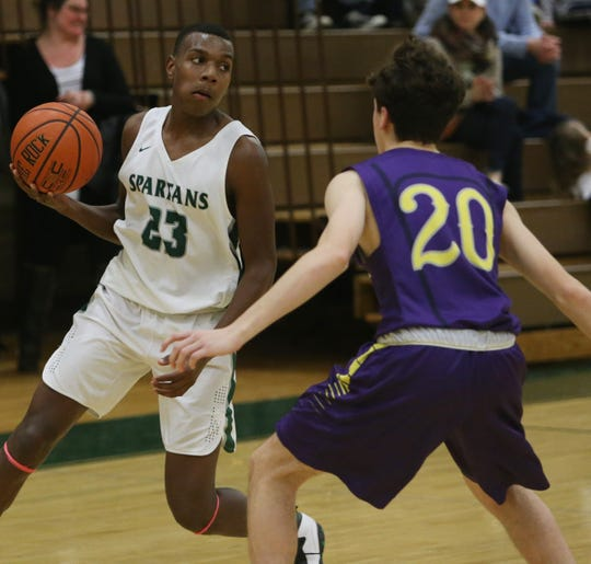 Spackenkill's Jayden Bennermon drives to the net passed Rhinebeck's Benjamin Fajardo during Friday's game in the Town of Poughkeepsie on January 24, 2020.