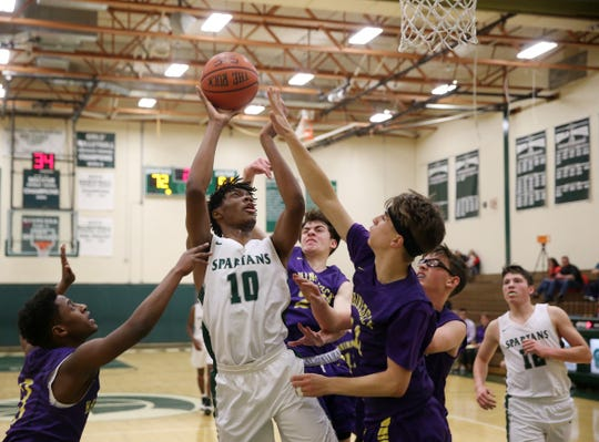 Spackenkill's Jaylen Rouse takes a jump shot between Rhinebeck's defense during Friday's game in the Town of Poughkeepsie on January 24, 2020.