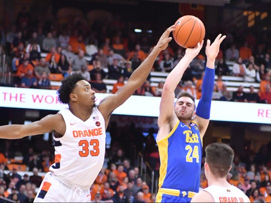 Syracuse forward Elijah Hughes (33) blocks the shot of Pittsburgh Panthers guard Ryan Murphy (24) in the first half at the Carrier Dome.