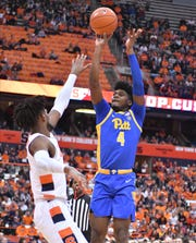 Former Irondequoit star and Pittsburgh Panthers guard Gerald Drumgoole Jr. (4) takes a jump shot as Syracuse Orange forward Quincy Guerrier defends in the first half Saturday at the Carrier Dome.