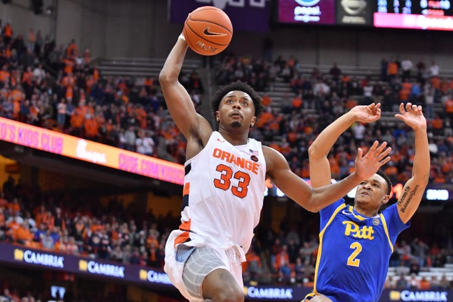 Jan 25, 2020; Syracuse, New York, USA; Syracuse Orange forward Elijah Hughes (33) goes to the basket as Pittsburgh Panthers guard Trey McGowens (2) pursues in the second half at the Carrier Dome. Mandatory Credit: Mark Konezny-USA TODAY Sports