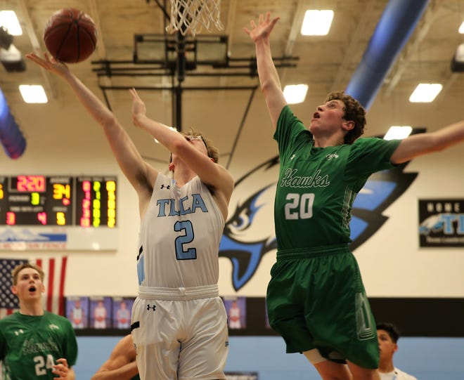 TLCA's Tyler Pilkinton puts up a shot as Wall's Jacob Richardson defends on the play during a District 4-3A showdown at the TLCA gym on Friday, Jan. 24, 2020.