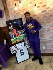 LSU wide receiver Terrace Marshall Jr. poses during a surprise party held in his honor Saturday in Bossier City.