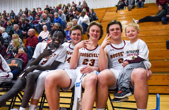 Roosevelt basketball players pose for a portrait with ball boy Karsten Meyer, 5, during the game against Rapid City Stevens on Friday, Jan. 24, 2020 at Roosevelt High School.