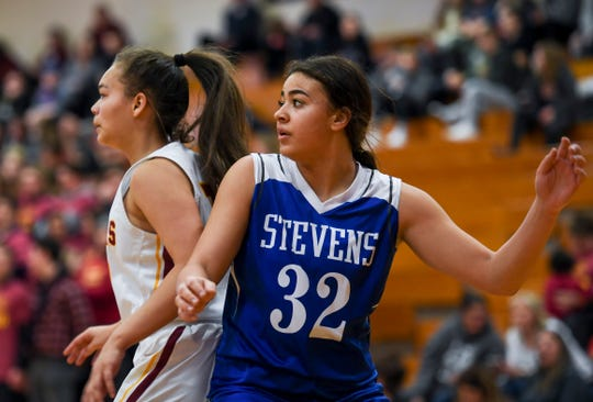 Rapid City Stevens' Kyah Watson (32) guards Roosevelt's Taliyah Hayes (12) during the game on Friday, Jan. 24, 2020 at Roosevelt High School.