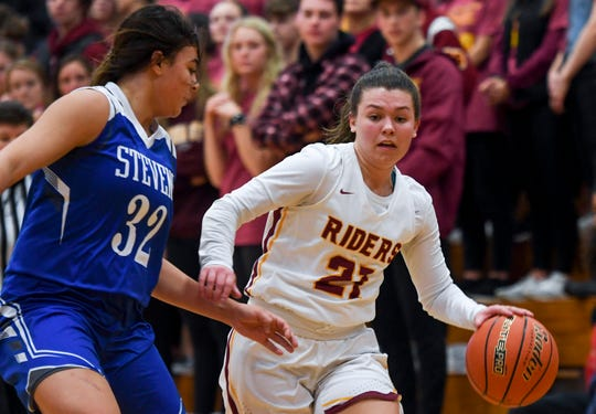 Roosevelt's Macey Nielson (21) dribbles toward the basket during the game against Rapid City Stevens on Friday, Jan. 24, 2020 at Roosevelt High School.