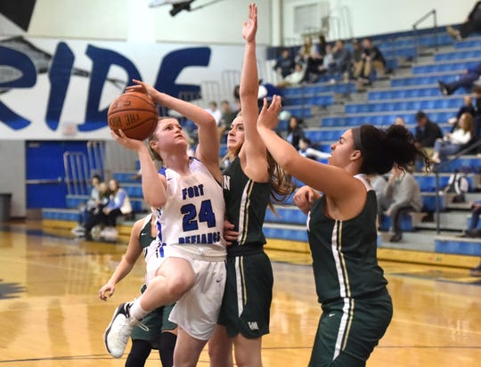 Fort Defiance's Lilian Berry drives for a shot against the Wilson defense in a Shenandoah District basketball game at the Don Landes Gym Friday night, Jan. 24.