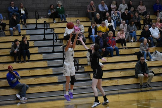 Desert Hills' Kami Bliss fires from three against Pine View. Bliss made six 3-pointers against the Panthers.