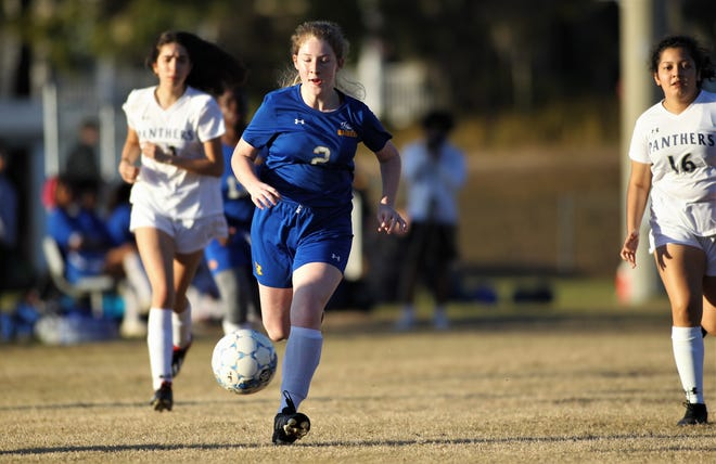 Rickards freshman Faith Register chases a through ball as the Raiders' girls soccer team beat St. John Paul II on Jan. 24, 2020 to tie a program record for wins with 11.