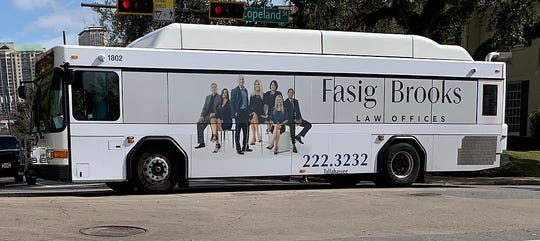 A Fasig Brooks ad on the side of a Tallahassee city bus.