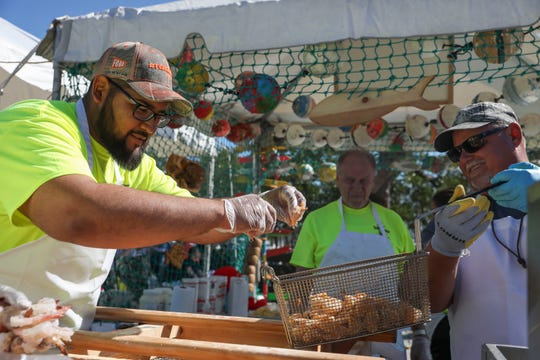 Thousands of people attend the 14th annual Port Salerno Seafood Festival at Manatee Pocket on Saturday, Jan. 25, 2020, in Port Salerno. The one day festival featured seafood, local craft beers, live music, children's activities, carnival rides and vendors.