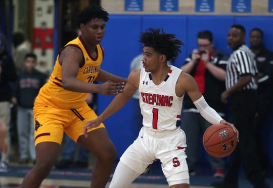 Stepinac's R.J. Davis (1) drives to the basket in front of Cardinal Hayes' Jazan Johnson (21) Darwyn Rosario (13) during basketball action at Stepinac High School in White Plains Jan. 24, 2020. Stepinac won the game 77-67.