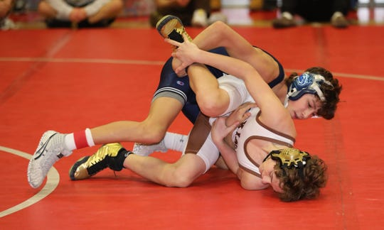 Cosmo Damiani from Suffern defeated Gregory Casvikes from Clarkstown South in the 99 pound category, during the 2020 Rockland County Wrestling Championships  at Tappan Zee High School in Orangeburg, Jan. 25, 2020.