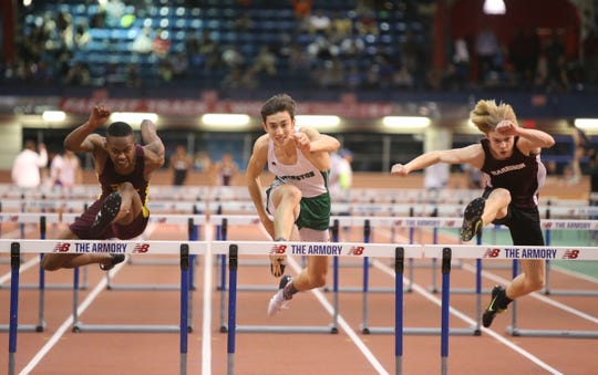 Mount Vernon's Antwone Messado, left, Irvington's Max Forte and Harrison's Peter Fischer run the 55-meter hurdles during the Westchester County Indoor Track & Field Championships at The Armory New Balance Track & Field Center in New York on Friday, January 24, 2020.  Messado won with a 7.85 time.