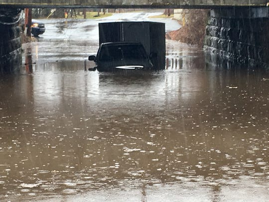 A truck with a trailer is stuck under railroad tracks on Stanton Christiana Road Saturday morning.