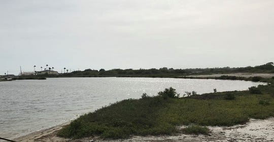 Duncan Cemetery lies near this small body of water that connects to a channel and then the Gulf of Mexico beyond.
