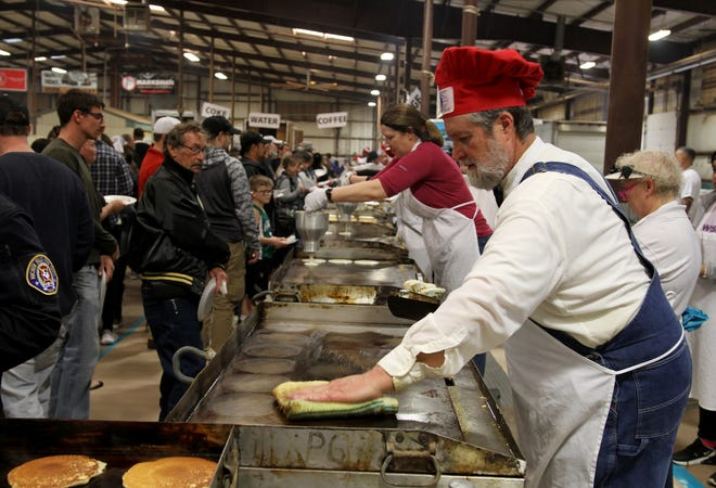 Pancakes are made to feed thousands at the University Kiwanis Club's Annual Pancake Festival Saturday, Jan. 25, 2020, at the J.S. Bridwell Agricultural Center.