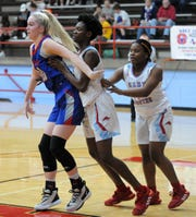 Hirschi's Niara Hightower (center) defends Graham's Cammi Teplicek in District 6-4A action at Hirschi Fieldhouse on Friday, Jan. 24, 2020.