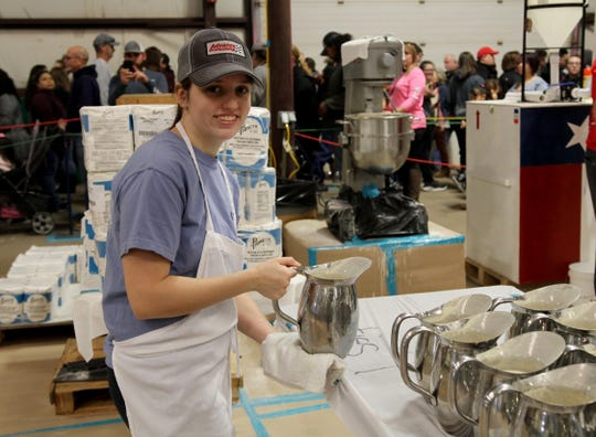 Angelica Munch helps keep the batter filled in her second year volunteering at the University Kiwanis Club's Annual Pancake Festival Saturday, Jan. 25, 2020, at the J.S. Bridwell Agricultural Center.