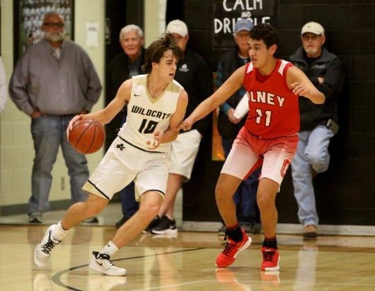 Archer City's Walter Kulhanek dribbles by Olney's Oscar Flores Friday, Jan. 24, 2020, in Archer City.