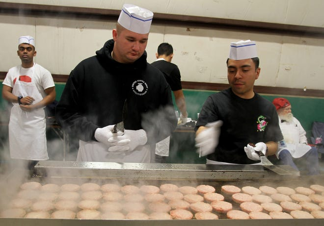 Thousands of sausae patties are cooked at the University Kiwanis Club's Annual Pancake Festival Saturday, Jan. 25, 2020, at the J.S. Bridwell Agricultural Center.