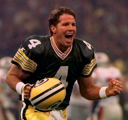ORG XMIT: NY157 FILE - This Jan. 26, 1997, file photo shows Green Bay Packers quarterback Brett Favre celebrating after throwing a touchdown pass to Andre Rison during first quarter action at Super Bowl XXXI in New Orleans.  A stretch of 297 straight starts, 321 counting playoffs, ended Monday, Dec. 13, 2010, because of a shoulder injury that not even the indestructible one could overcome. (AP Photo/Doug Mills, File)
