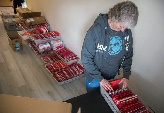 Mary Huston sorts through some of cards that her father, 104-year-old retired Marine Major Bill White, has received for Valentine's Day.